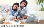 Купить «Man reassuring his wife about bills», видеоролик № 29678910, снято 3 ноября 2011 г. (c) Wavebreak Media / Фотобанк Лори