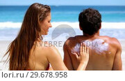 Купить «Woman applying cream on her boyfriend», видеоролик № 29678958, снято 15 ноября 2011 г. (c) Wavebreak Media / Фотобанк Лори