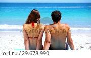 Купить «Couple sitting together on the sand», видеоролик № 29678990, снято 15 ноября 2011 г. (c) Wavebreak Media / Фотобанк Лори