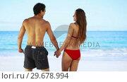 Купить «Happy couple holding their hands», видеоролик № 29678994, снято 15 ноября 2011 г. (c) Wavebreak Media / Фотобанк Лори