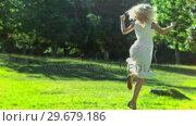 Купить «Woman dancing in slow motion», видеоролик № 29679186, снято 17 ноября 2011 г. (c) Wavebreak Media / Фотобанк Лори