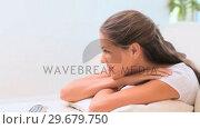 Купить «Smiling woman resting», видеоролик № 29679750, снято 4 ноября 2011 г. (c) Wavebreak Media / Фотобанк Лори