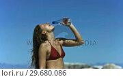 Купить «Young woman refreshing in slow motion», видеоролик № 29680086, снято 15 ноября 2011 г. (c) Wavebreak Media / Фотобанк Лори