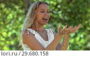 Купить «Blonde woman in slow motion catching water», видеоролик № 29680158, снято 14 ноября 2011 г. (c) Wavebreak Media / Фотобанк Лори