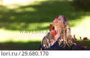 Купить «Blonde woman throwing leaves in slow motion», видеоролик № 29680170, снято 16 ноября 2011 г. (c) Wavebreak Media / Фотобанк Лори