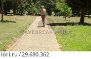 Купить «Jogging woman runs down the footpath», видеоролик № 29680362, снято 17 ноября 2011 г. (c) Wavebreak Media / Фотобанк Лори