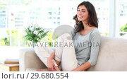 Купить «Woman laughing indoors», видеоролик № 29680554, снято 11 ноября 2011 г. (c) Wavebreak Media / Фотобанк Лори