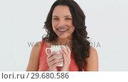 Купить «Girls sniffs her cup», видеоролик № 29680586, снято 11 ноября 2011 г. (c) Wavebreak Media / Фотобанк Лори
