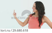 A lady raising her hand to point with her finger. Стоковое видео, агентство Wavebreak Media / Фотобанк Лори