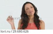 Купить «Woman holding a lightbulb in her hand», видеоролик № 29680626, снято 11 ноября 2011 г. (c) Wavebreak Media / Фотобанк Лори