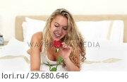 Blonde haired woman smelling a rose. Стоковое видео, агентство Wavebreak Media / Фотобанк Лори