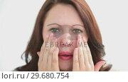 Купить «Brunette woman looking at the camera», видеоролик № 29680754, снято 22 ноября 2011 г. (c) Wavebreak Media / Фотобанк Лори