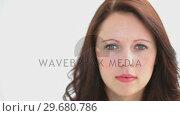 Купить «Smiling brunette looking at the camera», видеоролик № 29680786, снято 22 ноября 2011 г. (c) Wavebreak Media / Фотобанк Лори