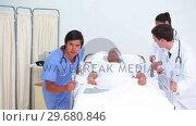 Купить «Serious medical team transferring a patient», видеоролик № 29680846, снято 22 ноября 2011 г. (c) Wavebreak Media / Фотобанк Лори