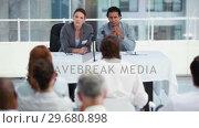 Купить «Business beople asking questions», видеоролик № 29680898, снято 22 ноября 2011 г. (c) Wavebreak Media / Фотобанк Лори