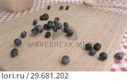 Купить «Blueberry falling in super slow motion on a wood board», видеоролик № 29681202, снято 24 февраля 2012 г. (c) Wavebreak Media / Фотобанк Лори