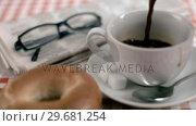 Купить «Coffee filling in super slow motion a cup», видеоролик № 29681254, снято 24 февраля 2012 г. (c) Wavebreak Media / Фотобанк Лори