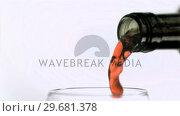 Купить «Red wine in super slow motion being spilled», видеоролик № 29681378, снято 1 марта 2012 г. (c) Wavebreak Media / Фотобанк Лори