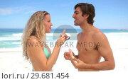Купить «Couple eating watermelon together», видеоролик № 29681454, снято 18 ноября 2011 г. (c) Wavebreak Media / Фотобанк Лори