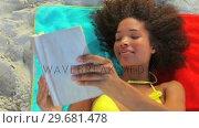 Купить «Tanned woman reading a book», видеоролик № 29681478, снято 18 ноября 2011 г. (c) Wavebreak Media / Фотобанк Лори