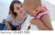 Купить «Mother kissing her baby girl», видеоролик № 29681582, снято 25 ноября 2011 г. (c) Wavebreak Media / Фотобанк Лори