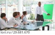 Купить «Business team listening to their boss», видеоролик № 29681670, снято 21 ноября 2011 г. (c) Wavebreak Media / Фотобанк Лори