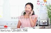 Купить «Woman happily talking on a phone», видеоролик № 29681798, снято 25 ноября 2011 г. (c) Wavebreak Media / Фотобанк Лори