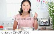 Купить «Woman drinking a cup of coffee», видеоролик № 29681806, снято 25 ноября 2011 г. (c) Wavebreak Media / Фотобанк Лори