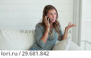 Купить «Woman laughing happily as she talks on a phone», видеоролик № 29681842, снято 25 ноября 2011 г. (c) Wavebreak Media / Фотобанк Лори