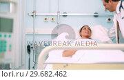 Купить «Obstetrician talking with a patient », видеоролик № 29682462, снято 24 апреля 2012 г. (c) Wavebreak Media / Фотобанк Лори