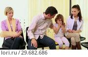 Купить «Woman with an injured arm sitting in a waiting room with other patients», видеоролик № 29682686, снято 27 апреля 2012 г. (c) Wavebreak Media / Фотобанк Лори