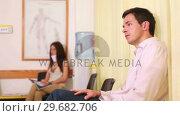 Купить «Patient waiting in the waiting room», видеоролик № 29682706, снято 27 апреля 2012 г. (c) Wavebreak Media / Фотобанк Лори