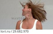 Купить «Woman tossing her hair », видеоролик № 29682970, снято 22 августа 2012 г. (c) Wavebreak Media / Фотобанк Лори