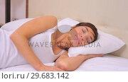 Купить «Yawning woman going to sleep», видеоролик № 29683142, снято 2 октября 2012 г. (c) Wavebreak Media / Фотобанк Лори
