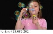 Купить «Happy girl playing with bubbles», видеоролик № 29683262, снято 14 августа 2012 г. (c) Wavebreak Media / Фотобанк Лори