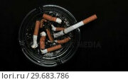Купить «Cigarette burning in ashtray», видеоролик № 29683786, снято 18 января 2013 г. (c) Wavebreak Media / Фотобанк Лори