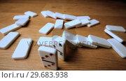 Купить «The domino effect on wooden table high angle shot», видеоролик № 29683938, снято 7 февраля 2013 г. (c) Wavebreak Media / Фотобанк Лори