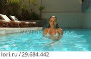 Купить «Attractive woman immersing her head in swimming pool», видеоролик № 29684442, снято 25 марта 2013 г. (c) Wavebreak Media / Фотобанк Лори