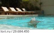 Купить «Woman dipping her head in swimming pool», видеоролик № 29684450, снято 25 марта 2013 г. (c) Wavebreak Media / Фотобанк Лори