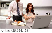 Купить «Woman calling her partner to look at laptop at breakfast», видеоролик № 29684458, снято 29 марта 2013 г. (c) Wavebreak Media / Фотобанк Лори