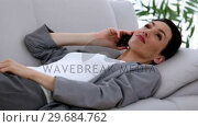 Купить «Attractive businesswoman relaxing on the couch», видеоролик № 29684762, снято 29 марта 2013 г. (c) Wavebreak Media / Фотобанк Лори