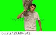 Купить «Handsome man holding his coat on green screen», видеоролик № 29684842, снято 7 апреля 2013 г. (c) Wavebreak Media / Фотобанк Лори