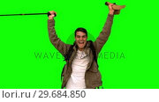 Купить «Cheerful man raising his hat on green screen», видеоролик № 29684850, снято 7 апреля 2013 г. (c) Wavebreak Media / Фотобанк Лори