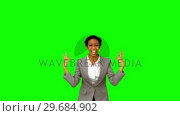 Купить «Pretty businesswoman raising arms on green screen», видеоролик № 29684902, снято 7 апреля 2013 г. (c) Wavebreak Media / Фотобанк Лори