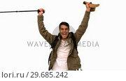Купить «Cheerful man raising his hat on white screen», видеоролик № 29685242, снято 7 апреля 2013 г. (c) Wavebreak Media / Фотобанк Лори