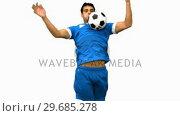 Купить «Handsome man controlling a football with his chest on white screen», видеоролик № 29685278, снято 7 апреля 2013 г. (c) Wavebreak Media / Фотобанк Лори