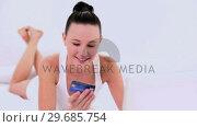Купить «Gleeful woman home shopping using her notebook», видеоролик № 29685754, снято 18 июля 2013 г. (c) Wavebreak Media / Фотобанк Лори