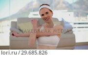 Купить «Content smiling woman stretching her arms», видеоролик № 29685826, снято 31 июля 2013 г. (c) Wavebreak Media / Фотобанк Лори