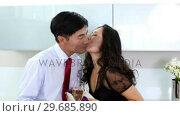 Купить «Happy couple celebrating their anniversary», видеоролик № 29685890, снято 29 августа 2013 г. (c) Wavebreak Media / Фотобанк Лори