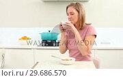 Купить «Mature woman drinking coffee at breakfast», видеоролик № 29686570, снято 18 октября 2013 г. (c) Wavebreak Media / Фотобанк Лори